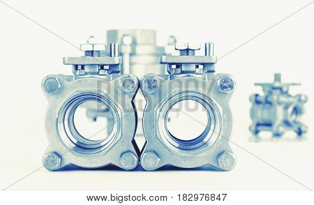 Group 3 valves different sizes 3 ball valve with selective focus on thread fittings Stainless steel valve. Industry concept.