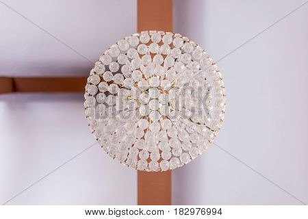 A clear symmetry ceiling lamp with T-junction woods