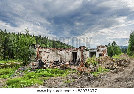 ruins of an abandoned building on the Bank of the Usva river. Russia The Urals