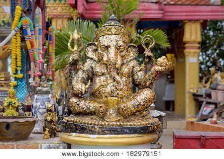 CHONBURI THAILAND - JANUARY 13 2015: Black Ganesha statue with gold leaf.