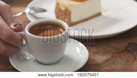 teenage girl eating cheesecake with caramel and drink coffee, 4k photo