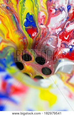 Liquid paint flow in to the water drain as colorful abstract artistic creativity inspiration idea background