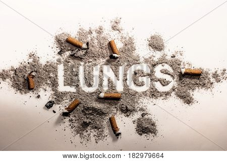 Lung word in cigarette ash and bud as disease illness sickness addiction bad health care medicine danger concept image