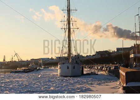 Sailing ship in the ice harbor St. Petersburg winter January