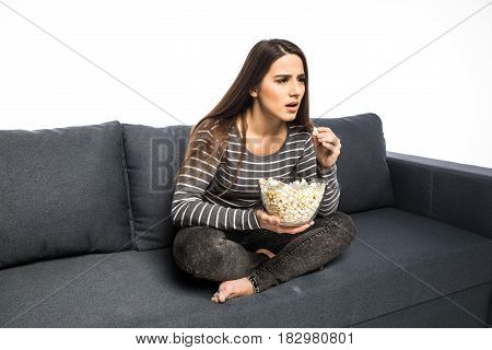 Young Woman Spends His Free Time Watching Tv On The Couch Munching Chips And Popcorn White Backgroun