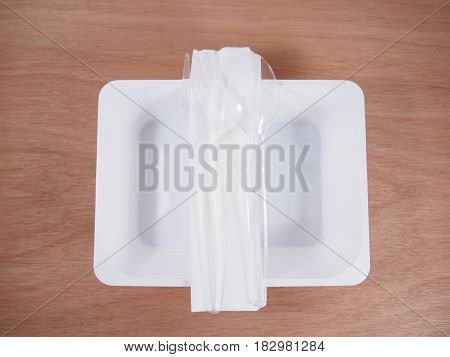 Disposable equipment empty kitchen ware on wooden background
