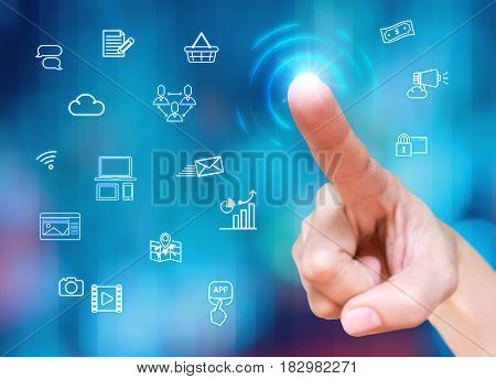 Finger touch on screen with Digital marketing feature icon at blur blue backgroundtechnology concept.