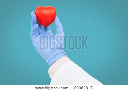 Medicine And Healthcare - Doctor Holding Heart Toy On White Background