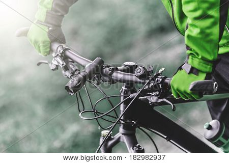 Equiped biker holds bike helm, sport ride concept