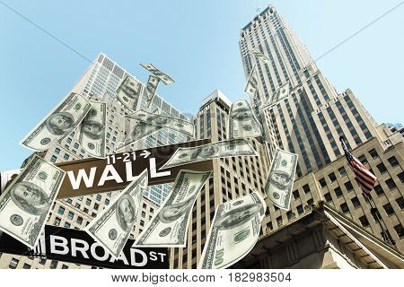 Hundred dollar money bills falling down the buildings of the Wall street. The road signs wall street corner broad street show the location.