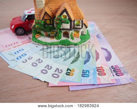 Banknotes money earn and save for a house a car plan concept
