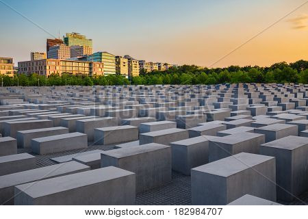 Famous Jewish Holocaust Memorial near Brandenburger Tor (Brandenburg Gate) at sunset in summer Berlin Mitte Germany