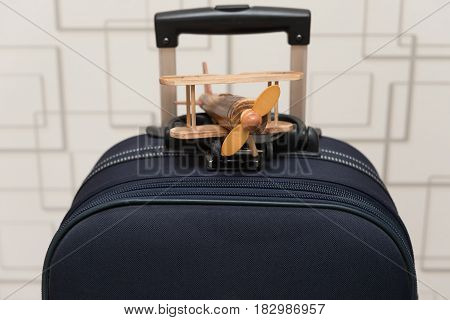 airplane model on top of a luggage