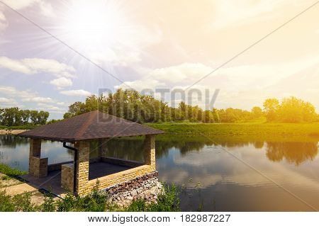 Beautiful alcove on a lake in spring sunny day with bright sunlight. Soft effect.