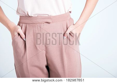 Elegant Business Woman Holding Hands In Pockets Of Beautiful Pants