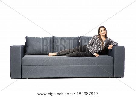 Young Female Lying On A Sofa Isolated On White Background