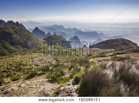 brasil mountains with green forest and steep rocks with blue sky and clouds at sunrise