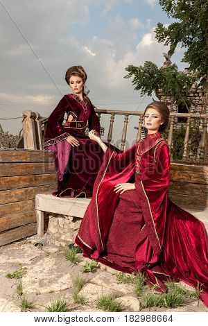 Two ladies in glamour vintage clothes on a boat. Luxury and glamour
