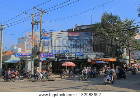 HO CHI MINH CITY VIETNAM - NOVEMBER 26, 2016: Unidentified people visit Dan Sinh market. Dan Sinh market is known for the place to buy army and war souvenirs and memorabilia.