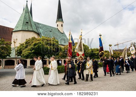 AltoettingGermany-April 232017: A procession on St Konrad von Parzham day makes its way after Sunday mass