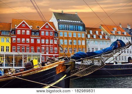 Yacht and color buildings in Nyhavn in the old center of Copenhagen, Denmark. poster