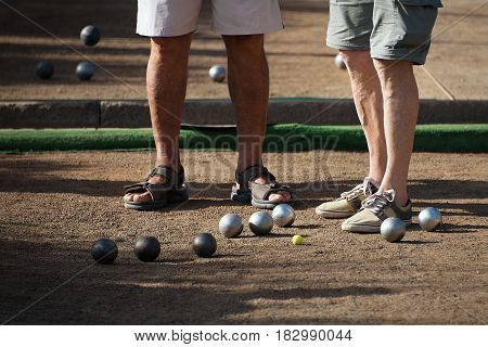 Old mens playing petanque in a city park,relaxation game