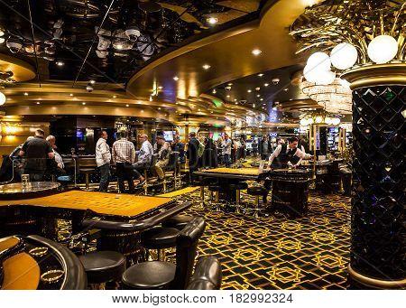 CRUISE LINER SPLENDIDA - APRIL 4, 2017: People in gambling casino of Cruise liner Splendida