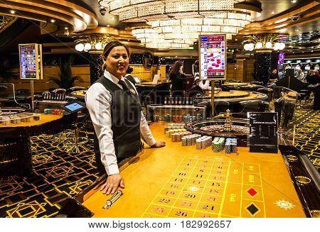 Cruise liner Splendida - April 23, 2017: Croupier in gaming casino interior of Cruise liner Splendida, MSC