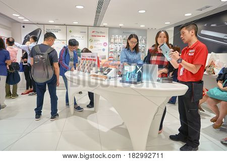HONG KONG - CIRCA NOVEMBER, 2016: people at SmarTone shop. SmarTone Telecommunications Holdings Limited is a wireless communications carrier with operating subsidiaries in Hong Kong and Macau.