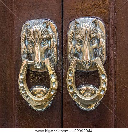 door with horse decoration in Spain, Cadiz