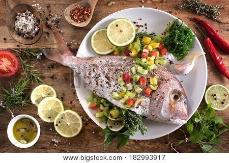 Dorade fish with herbs filling and gazpacho for grilling