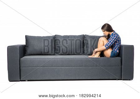 Sad Depressed Woman At Home, She Is Sitting On The Couch, Loneliness And Sadness Concept