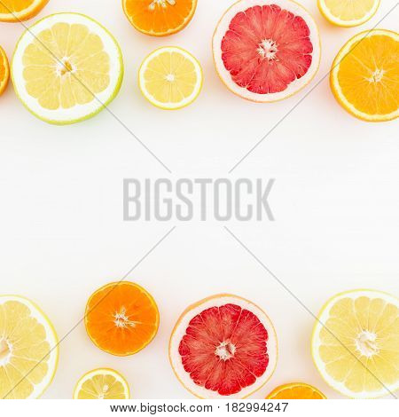 Food Frame of mix with fresh lemon, orange, mandarin, grapefruit and sweetie on white background. Flat lay, top view.