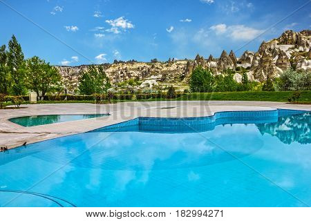 mountains and swimming pool in Goreme, Cappadocia, Turkey.
