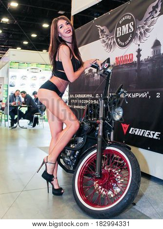 St. Petersburg Russia - 15 April, Elegant fashion model,15 April, 2017. International Motor Show IMIS-2017 in Expoforurum. Models on motorcycles presented at the motor show.