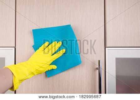 Hand In Protective Glove Cleaning Wooden Furniture With Rag. Early Spring Cleaning Or Regular Clean