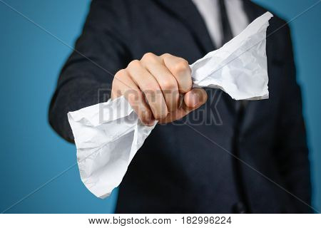 Businessman Holding A Crumpled Sheet Of A4 Paper. Close Up. Isolated