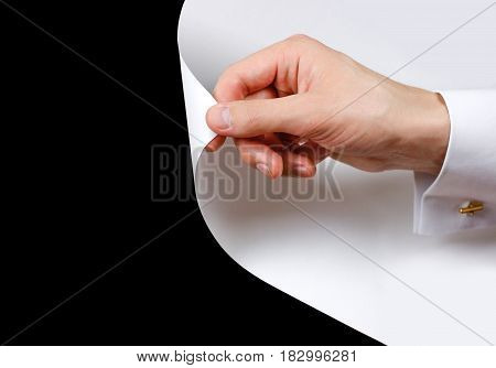Close Up Hand Turn White Page. Turning The Page From White To Black. Isolated