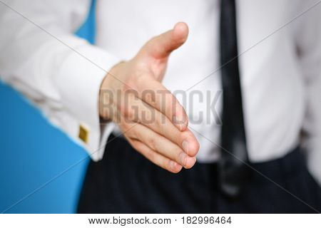 Close Up. Businessman Offering Handshake To You. The Man Holds Out His Hand