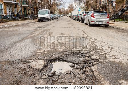 Montreal, Canada - 21 April 2017: Large Unrepaired Pothole On Cartier Street