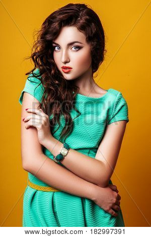 Fashion photo of young model woman on yellow background. Girl posing. Studio photo.