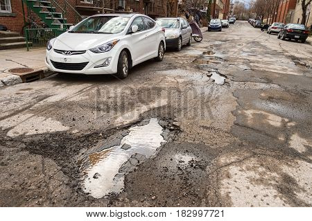 Montreal, Canada - 21 April 2017: Large Unrepaired Potholes On Chabot Street