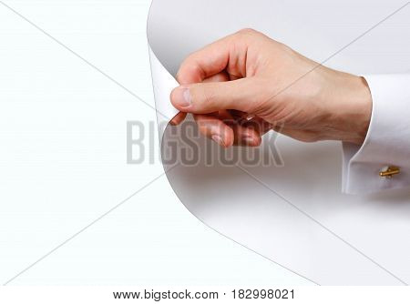 Close Up Hand Turn White Page. Turning The Page From White To White Background. Isolated