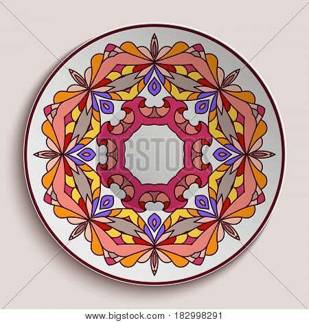 Empty plate with ornamental border, decorative porcelain saucer with colorful round pattern