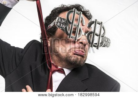 Fun Businessman with suit and glasses in the form of dollars. Expressions of stress, overwhelm and craving for money
