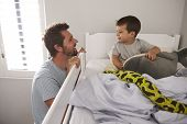 Father Saying Goodnight To Son At Bedtime poster