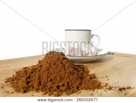 Coffee Cup, Rakhat-lukum On Plate  On Wooden Table.