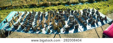 Livestock Fair celebration metal wind chimes handmade work in the rural western Ukraine, the Carpathians in front of a herd of sheep pasture on alpine meadows in the mountains poster