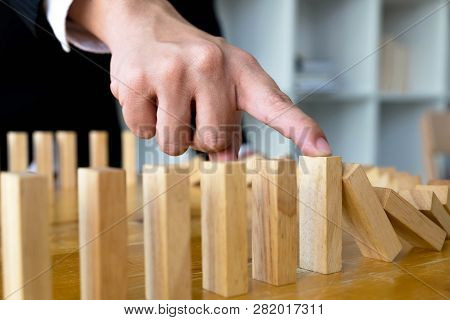 Business Finger Stops Domino Continuous Overturned Meaning That Hindered Business Failure. Stop Over