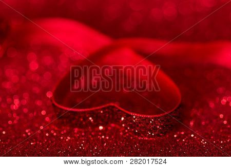 Heart Is Lined With Bright Red Ribbon On Shiny Background For Valentine's Day
